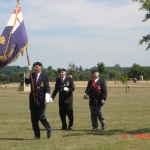 The standard bearers open the ceremony of remembrance