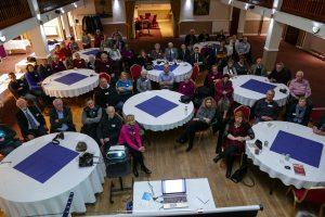Assembled Dunedin Society members in the Trafalgar Ballroom listening to Stuart Gill's talk