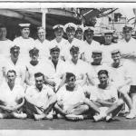Baker, back row far right, on board D