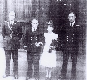 Tempy. Instr. Lt. G.D. L. Harcombe BSC with his Bride and - left Capt. H.R.Maul, R.M. - and temporary Captain, E.C. Thornton DSC